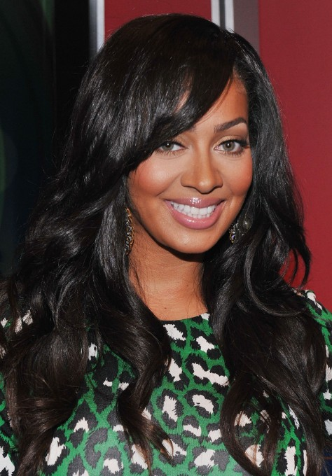 Medium Layers with Side Swept Bangs